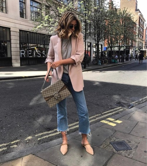 Street Style : Emma Hillis wearing a blazer in a playful shade of pale pink,…