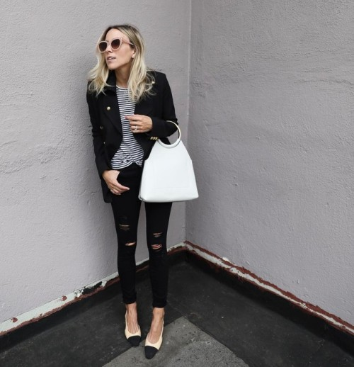 Street Style : Jacey Dupriehas paired black jeans with a horizontally striped…